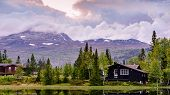 Holiday Cottages On The Lake In The Mountains In Norway, Scandinavia, Gaustatoppen.. poster