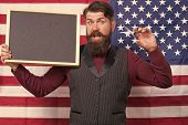 Hipster Chic. Bearded Hipster Holding Scissors And Blackboard In Class. Hipster Man On American Flag poster