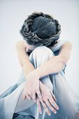 picture of ten years old  - Sad and Lonely ten year old girl in dress looking down - JPG