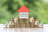Model House On A Coin, Placed Near The Orange Roof House, Coins, Investment Concepts, Finance, Accou poster