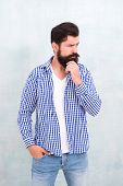 Attractiveness Concept. Well Groomed Guy. Brutal Handsome Hipster Man Grey Wall Background. Bearded  poster