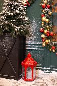 Christmas Lantern In Snow With A Christmas Tree And Garland With Toys In Evening Scene. Christmas La poster