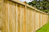 image of wooden fence  - wooden fence with green lawn and trees - JPG