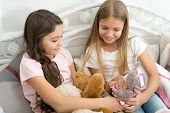 Pajamas Party. Sisters Sharing Toys. Sisters Best Friends. Kids Play Toys In Bed. Little Girls Spend poster