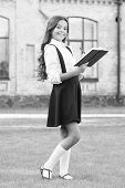 Girl Ready For School. Happy Girl Back To School. Cute Little Girl Smile With Book Outdoor. Adorable poster