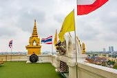 View From Wat Saket Temple In Bangkok, Thailand. Detail Of Flags On Top Of Golden Mount. Thailand Na poster