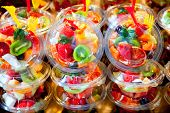 pic of tupperware  - Colorful natural fruit salad transparent glasses in a row - JPG