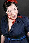 stock photo of rockabilly  - Portrait of an angry girl dressed in Rockabilly fashion - JPG