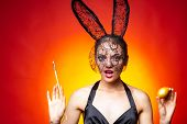 Respect Traditions. Happy Easter Day. Bunny Rabbit Girl Hold Brush Painting Egg Red Background. Cute poster