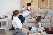 Dad And Children Have Fun Together At Home, Dad Sits On The Couch And Photographs His Children. Son  poster