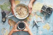 Top View Hands People Planning Vacation With World Map While Doing Breakfast With Cereal Milk - Coup poster