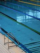 Indoor Swimming Pool. Ropes Divide The Swimming Lanes Of An Indoor Pool Ahead Of A Swim Meet Inside  poster