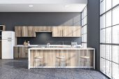 Stylish Gray Kitchen With Wooden Bar poster