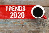 Trends 2020 / Cup Of Coffee With Trends Inscription On Wooden Background. poster