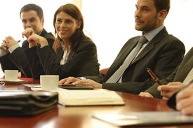 pic of business meetings  - conference . group of 3 business people at the desk