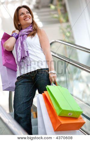 Shopping Woman On Scalators