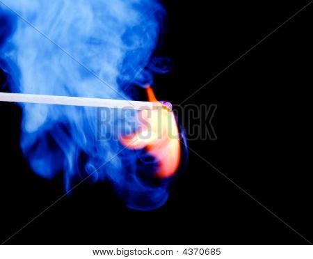 Burning Match With Blue Smoke Over Black