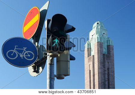 Traffic Lights And Road Signs Against Sky