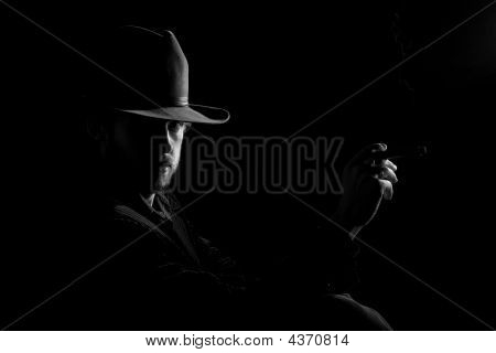 Man In Hat With Cigar