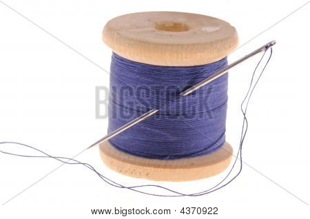 Spool Of Thread And Sewing Needle
