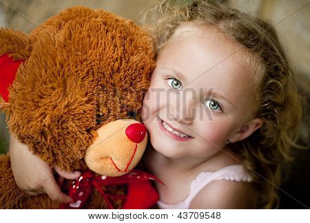 Girl With Her Teddy