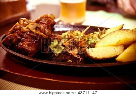 Tasty grilled steak meat and sauteed potatoes
