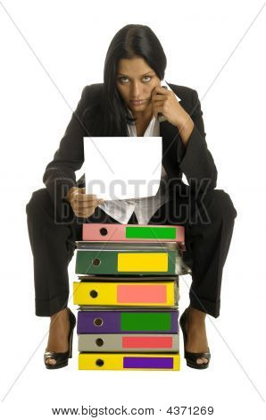 Woman Is Sitting On The Binders And Reading