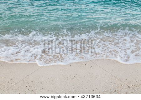 Close Up Of Wave Spread On The Beach