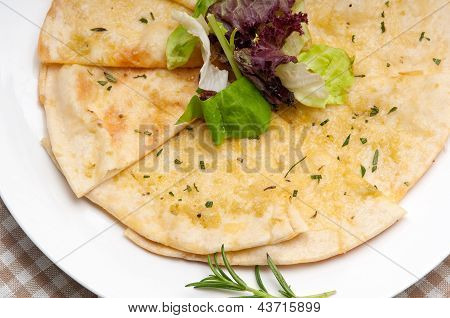 Garlic Pita Bread Pizza With Salad On Top