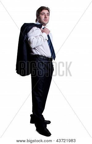 Businessman With Jacket On Shoulder And Hand In Pocke