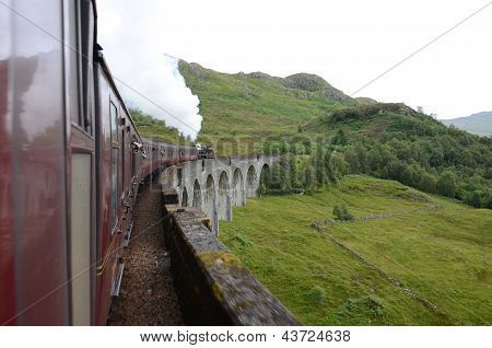 Jacobite steam train crossing Glenfinnan viaduct.