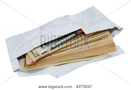 Dollars And Syringe In Open Envelope