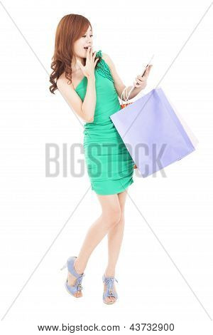 Surprised Young Woman Looking Tablet Pc And Shopping On The Internet