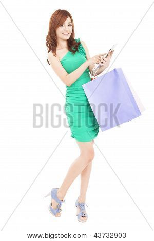 Beautiful Young Woman With Tablet Pc And Shopping Bag