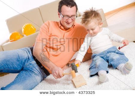 Father And Baby Boy Playing