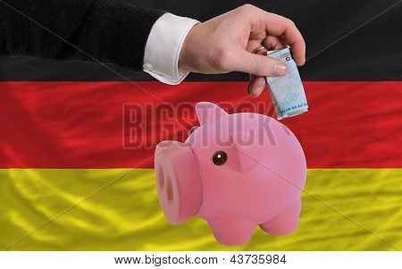 Funding Euro Into Piggy Rich Bank National Flag Of Germany