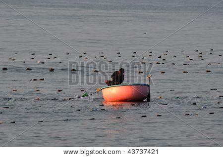 Vietnamese fisher fishing in Mui Ne, Vietnam