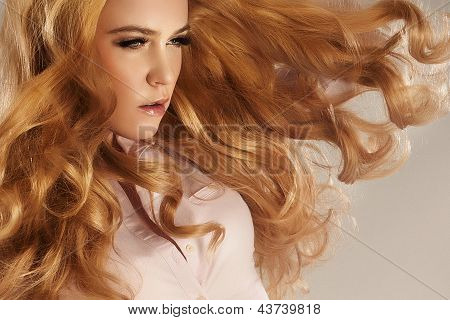 Portrait Of Beautiful Young Woman With Long Red Hair.
