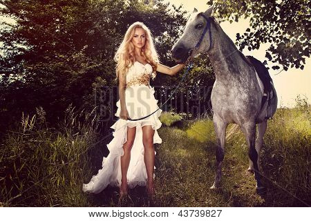 Beautiful Young Bride With Horse In Garden.