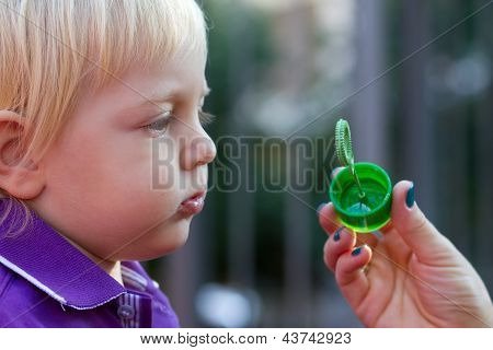 Cute Baby Boy Blowing Bubbles