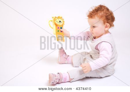 Redhead Baby Playing