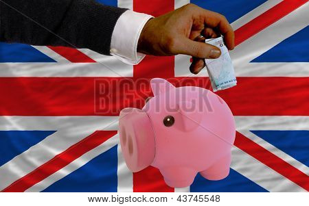 Funding Euro Into Piggy Rich Bank National Flag Of United Kingdom