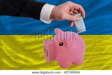 Funding Euro Into Piggy Rich Bank National Flag Of Ukraine