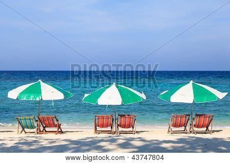 Colorful Beach Chairs And Umbrellas On The Beach
