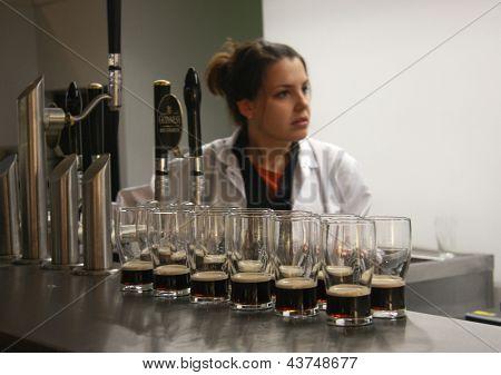 Dublin, Ireland - June 19, 2008: Multiple Glasses Of Beer Served For Tasting At The Guinness Brewery