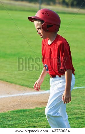 Baseball Player Walking Across Field.