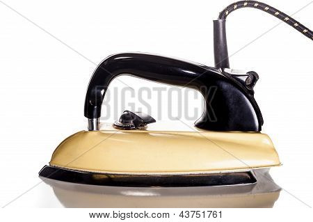 British vintage forties yellow electric iron - isolated on white