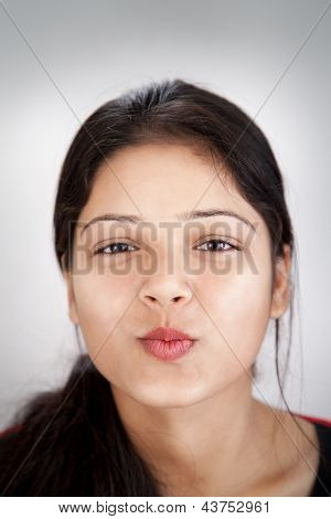 Attractive Indian girl smooch