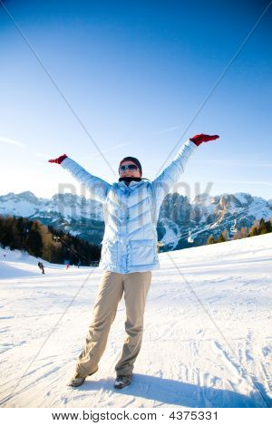 Happy Woman Under The Sunlight In Mountain Resort