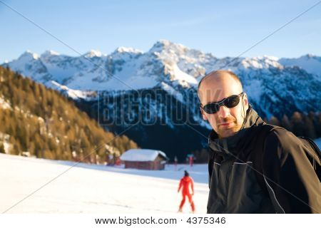 Young Man In The Alps Mountains